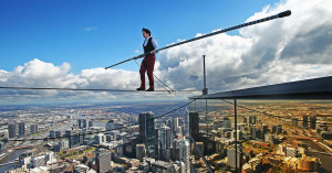 MELBOURNE, AUSTRALIA - SEPTEMBER 16:  High-wire artist Kane Petersen successfully walks a tightrope 300 metres above the ground at Eureka Skydeck on September 16, 2015 in Melbourne, Australia. The walk was the highest tightrope walk ever attempted in the Southern Hemisphere. The stunt is to mark the arrival of the film 'The Walk' to Australian cinemas in October. The stunt saw Kane mimic the film's French high-wire artist Philippe Petit, who successfully walked between the twin towers of the World Trade Center in 1974.  (Photo by Scott Barbour/Getty Images) *** BESTPIX ***